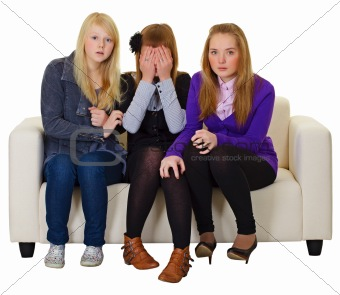 Three girls look a horror movie