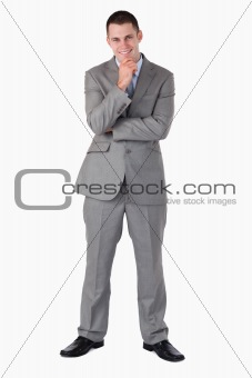 Smiling and thinking businessman