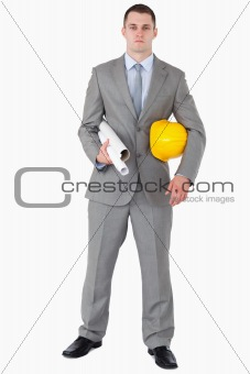 Architect with helmet and plans