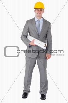 Smiling architect with plans wearing helm
