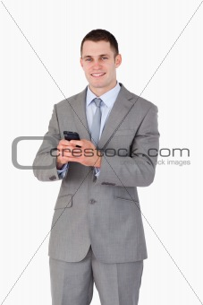 Close up of businessman got good news via text message