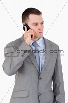 Close up of serious looking businessman on the phone