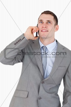 Close up of businessman on the phone looking up