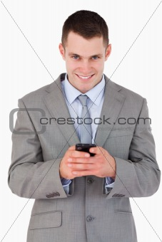 Close up of businessman getting good news via text message