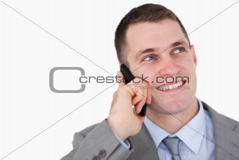 Close up of businessman looking up while on the phone
