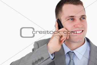 Close up of businessman looking up while on the mobile phone