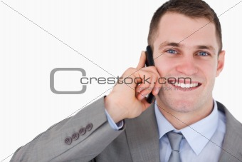 Close up of businessman on the mobile phone looking up