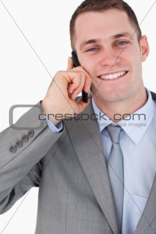 Close up of happy businessman on the phone