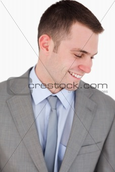 Close up of smiling businessman looking down