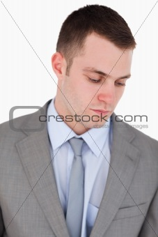 Close up of serious businessman looking down