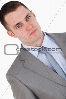 Close up of confident looking young businessman