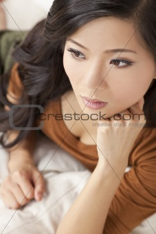 Beautiful Thoughtful Chinese Oriental Asian Woman Relaxing
