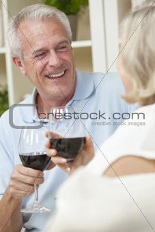 Happy Senior Man & Woman Couple Drinking Wine at Home