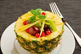 Pineapple stuffed with fruits