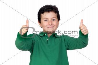 Beautiful boy dressed in green saying Ok