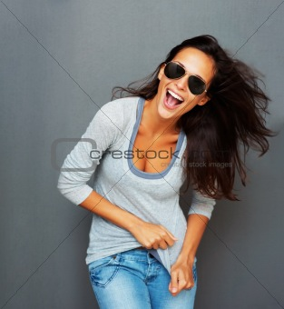 Windswept woman playing with shirt