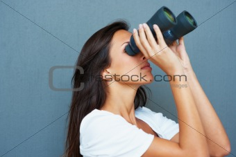 Brunette looking through binoculars