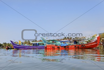 Colorful fishing boats moored at Kochin Backwater