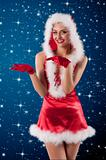 beauty girl in a red santa claus dress with white feathers