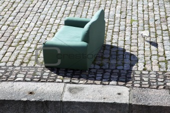 Sofa on cobblestone