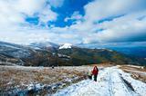 Family on autumn  mountain plateau first winter snow