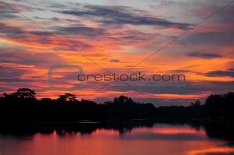 Red sunset sky on a reservoir