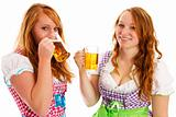 two bavarian girls laughing and drinking beer