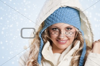 blue hat on a blond girl