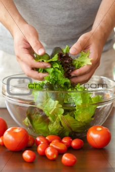 man preparing salad