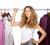 Portrait of a blonde beautiful girl selecting clothes