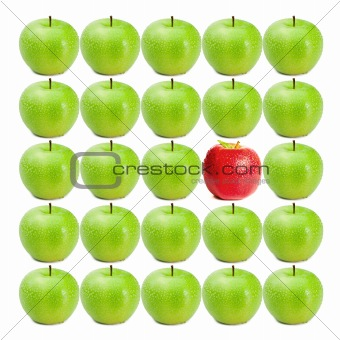 Green wet apples surrounding red apple