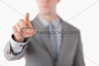 A businessman's hand touching something