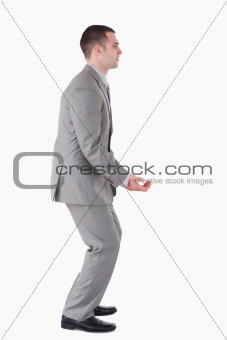 Portrait of a handsome businessman carrying something