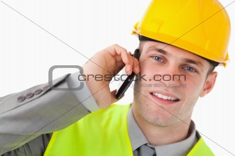 Close up of a young builder making a phone call