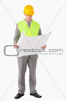 Portrait of an architect looking at a plan