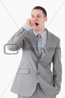 Portrait of a businessman yawning