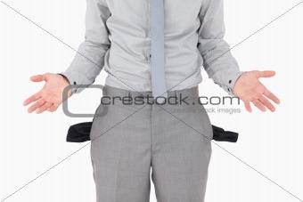 Broke businessman with empty pockets