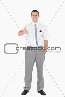 Portrait of an office worker with the thumb up