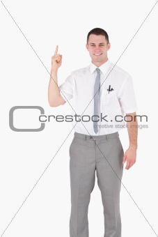 Portrait of an office worker pointing at something