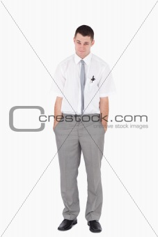 Portrait of an office worker with the hands on his pockets