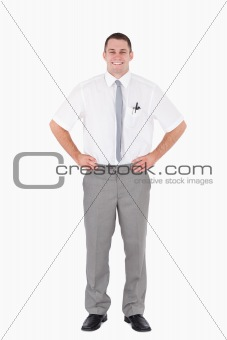 Portrait of an office worker with the hands on his hips
