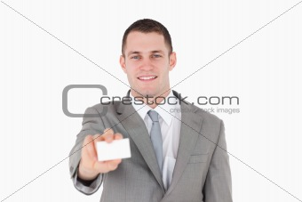 Smiling businessman showing a blank business card