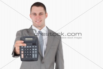Businessman showing a calculator