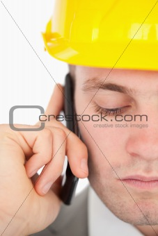 Close up of a sad architect making a phone call