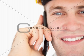 Close up of a handsome architect making a phone call