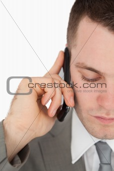 Close up of a tired businessman making a phone call