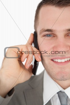 Close up of a smiling businessman making a phone call
