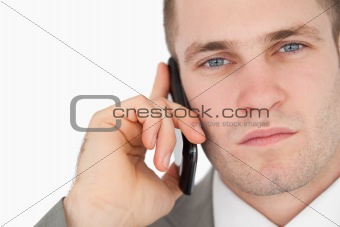 Close up of a focused businessman making a phone call