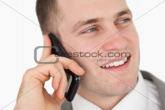 Close up of a handsome entrepreneur making a phone call