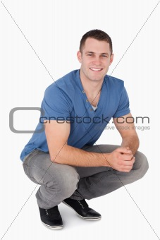 Portrait of a man squatting